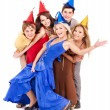 Foto Stock: Group of young in party hat.