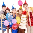 Group of  in party hat holding gift box. - Stock Photo