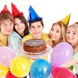 Stock Photo: Group holding cake.