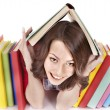 Girl with pile color book. — Stock Photo #5189244