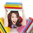 Girl with pile color book . — Stock Photo #5189250