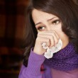 Young woman with handkerchief having cold. — Stock Photo #5189259