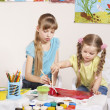 Child painting in preschool. — Stock Photo #5189291