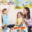 Children painting in preschool. - Foto de Stock