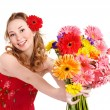 Happy young woman giving flowers. — Stock Photo