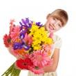 Stock Photo: Happy child holding flowers.