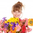 Happy child holding flowers. — Stock Photo #5189575