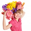 Child with with flowers on her hair. — Stock Photo