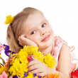 Happy child holding flowers. - Stock Photo