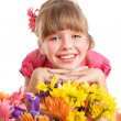 Royalty-Free Stock Photo: Happy child holding flowers.