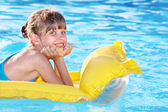 Child swimming on inflatable beach mattress. — Stock Photo