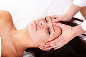 Beautiful girl and beautician. Facial massage. — Stock Photo
