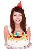 Girl in party hat holding cake. — Stock Photo