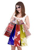 Girl in glasses with shopping bag. Isolated. — Stock Photo