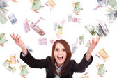 Girl with flying money. — Stock Photo