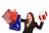 Young woman holding shopping bag and gift box. — Stock Photo