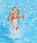 Child swim in swimming pool. — Stock Photo