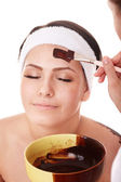 Girl having chocolate facial mask. — Stock Photo