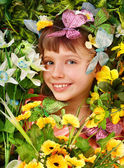 Girl with butterfly and flower. — Stock Photo