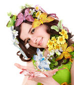 Girl with butterfly and flower on head. Spring hair. — Stock Photo