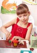 Child playing with plasticine in school. — Stock Photo