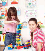 Child with Lego block and construction set in play room. — Stock Photo
