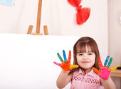 Child making hand prints. — Stock Photo