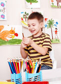 Child with pencil in play room. — Stock Photo
