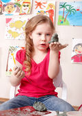 Kid playing with clay. — Stock Photo