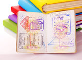 Pile of book with passport. — Stock Photo