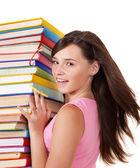 Dívka s knihou barevné hromádky. — Stock fotografie