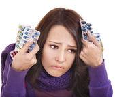 Girl having flu taking pills — Stock Photo