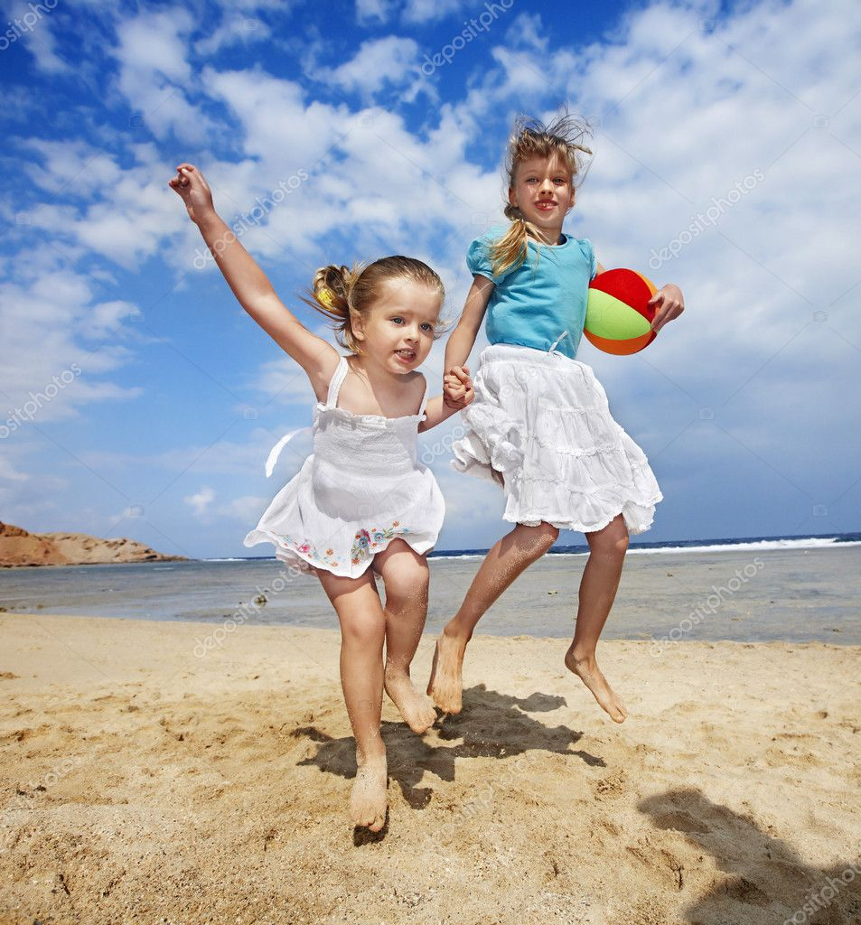 Children playing on beach. - Stock Image