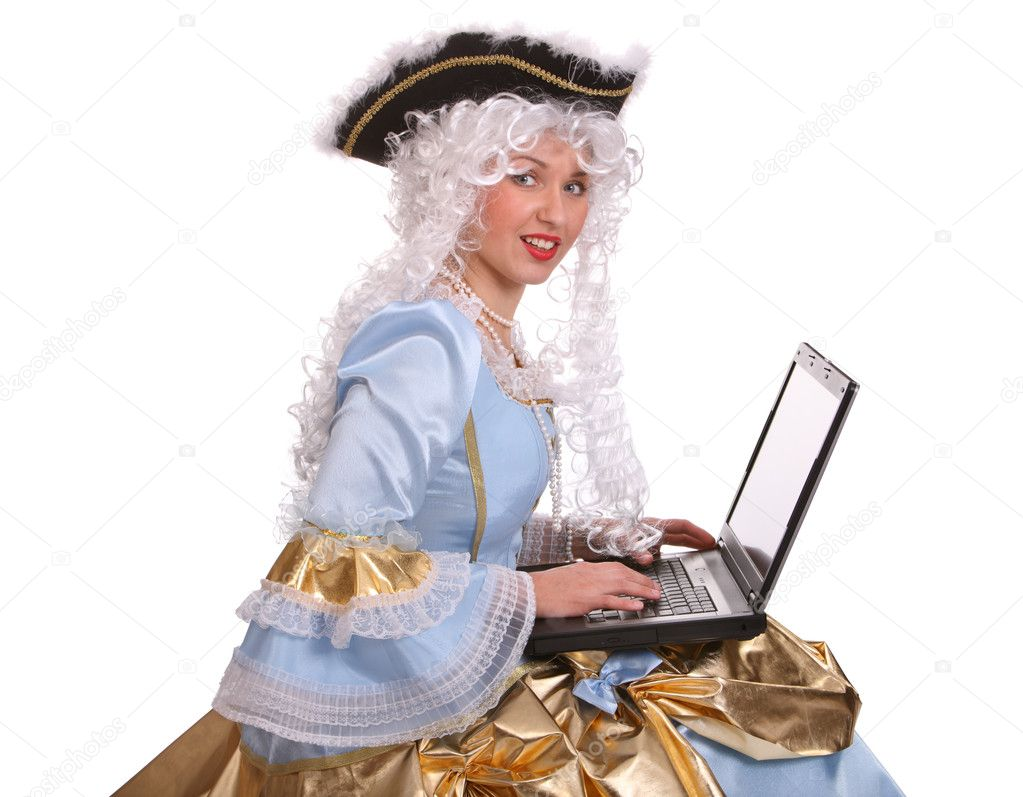 Woman in ancient dress of marquise with laptop. — Stock Photo #5187807