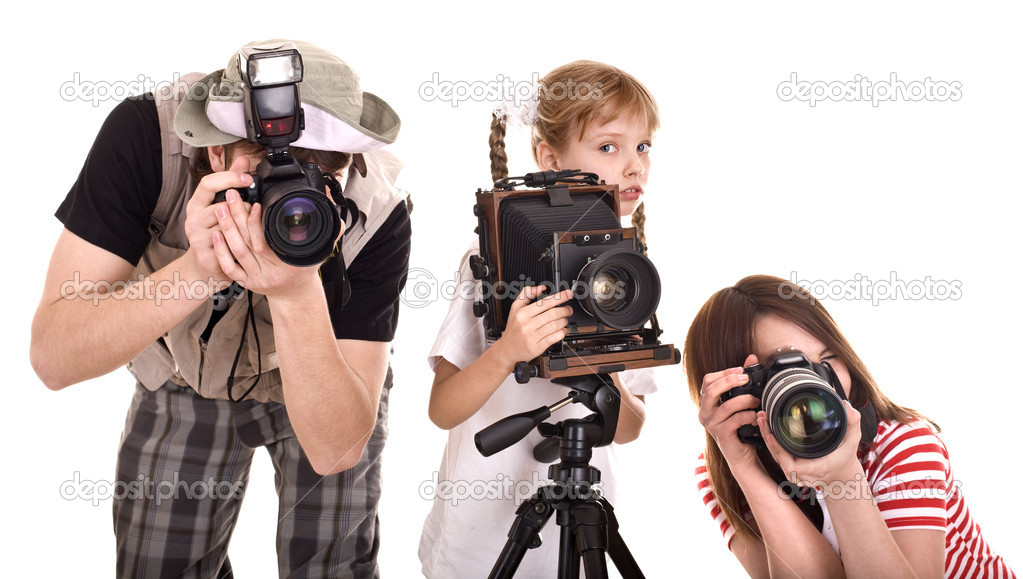Photographer with his family taking picture. Isolated. — Stockfoto #5188092