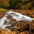 Water rushing down river - Foto Stock