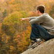 Young hiker relaxing on rock — Stock Photo