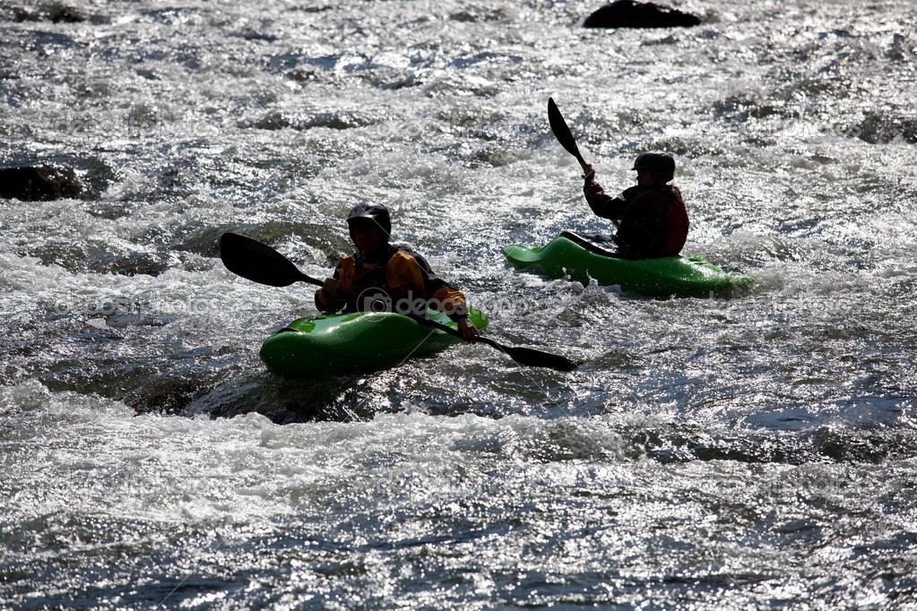 Canoeing in white water in rapids on river — Stock Photo #4124456