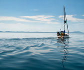 White yacht sailing on calm sea — Stock Photo