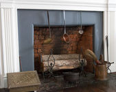 Old fireplace with logs — Stock Photo