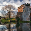 Whittington Castle in Shropshire reflecting on moat - Stock Photo