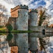 Whittington Castle in Shropshire reflecting on moat — Stock Photo