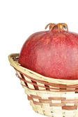 Pomegranate in the basket — Stock Photo