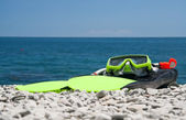 Snorekl equipment on beach sea — Stock Photo