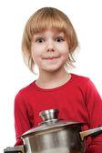 Happy chef girl stirring soup — Stock Photo