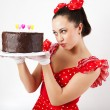 Young beautiful woman with a cake. — Stock Photo #4397297