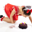 Young beautiful woman with a cake. - Stock Photo