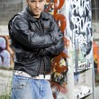 Man in graffiti background — Stock Photo #4783030