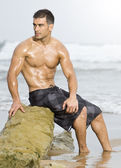 Sexy man beach — Stockfoto