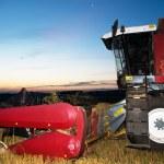 Harvesting combine at sunset — Stock Photo